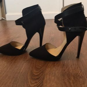 Black peep toe pump with leather strap